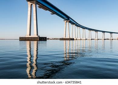 Tall concrete/steel girders supporting the Coronado Bay Bridge and spanning San Diego Bay.