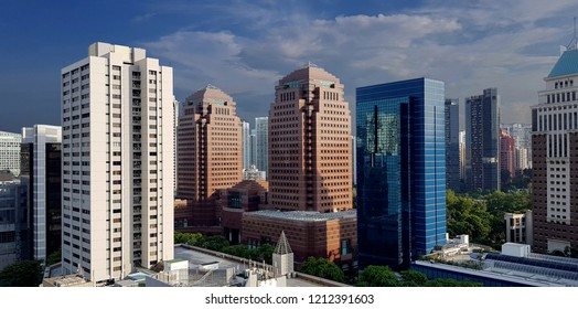 Tall contemporary city buildings / skyscrapers in different colours and cladding materials.