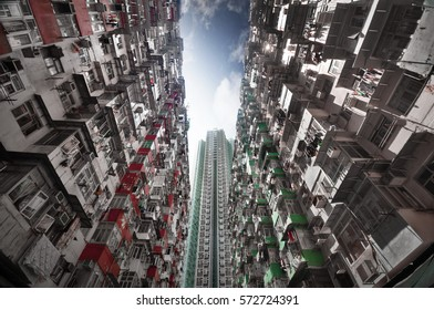Tall and dense residential apartment tower in Hong Kong.
