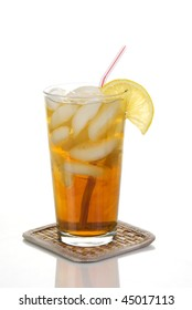 A tall glass of cold iced tea with lemon