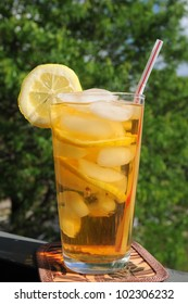 A tall glass of iced tea served on the patio