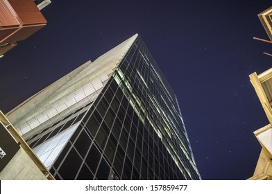 Tall glass office tower on a clear night - the BHP Billiton Centre in Melbourne, Australia.