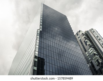 Tall glass office tower on an overcast day - the BHP Billiton Centre in Melbourne, Australia.