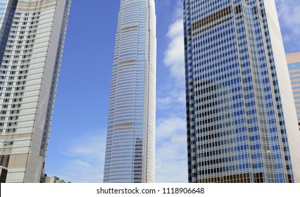Tall Glass Skycraper IFC building in Hong Kong with blue sky