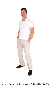 A tall handsome middle age man standing in a beige slacks and white