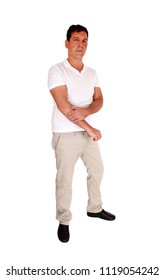 A tall handsome middle age man standing in beige slacks and white