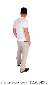 A tall handsome middle age man standing in a beige slacks and white t-shirt 