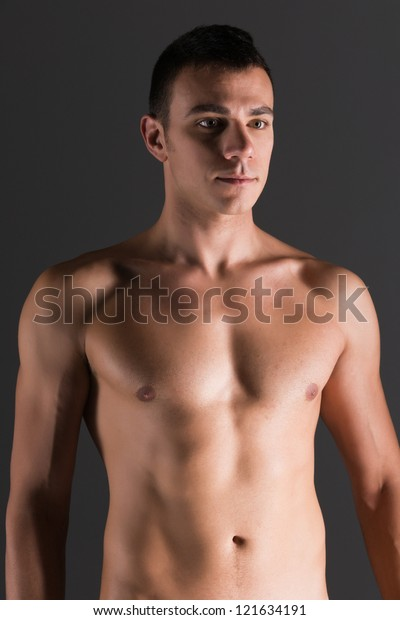 Young Handsome Naked Man Isolated On Gray Background