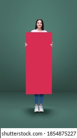 Tall high woman and long banner isolated on green studio background. Unusual delighted and long. Copyspace for offer, advertising, artwork, inspiration and hobby, mood concept. Humor, weird collage. - Shutterstock ID 1854875227