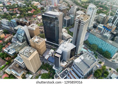 Tall high-rise building towers in modern urban city CBD - aerial elevated view top down. North Sydney, Australia.