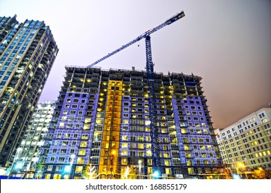 tall highrise building under construction in a big city