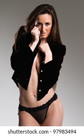 Tall long haired brunette in sweater and panties