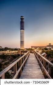 The tall and majestic lighthouse of Oak Island in Brunswick County, North Carolina. One of the best beaches in the Eastern North Carolina, 45 minutes from Wilmington, the home of Michael Jordan.