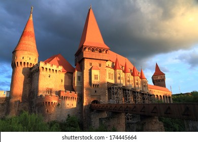 Tall medieval castle illuminated by sunset light