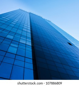 Tall modern office building over clear blue sky
