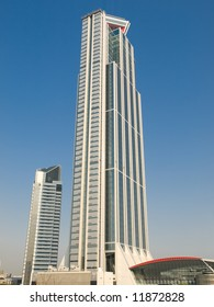 Tall office building with a clear blue sky in the background
