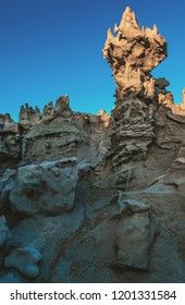 A tall, otherworldly formation towers above other unique and rare Gilsonite geologic formations and hoodoos in Fantasy Canyon, a tiny and fascinating piece of BLM land outside of Vernal, Utah, USA.