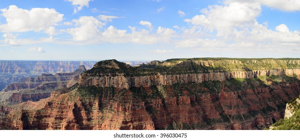 Tall red rocks mountain side, steep cliffs. Grand Canyon National Park.