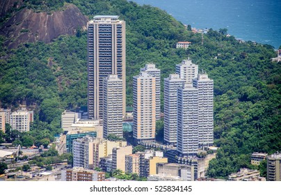 Tall residential buildings in Botafogo, Humaita of Zona Sul on the background of the green hill, view from Mirante Dona Marta at the National Park of Tijuca, Rio de Janeiro, Brazil