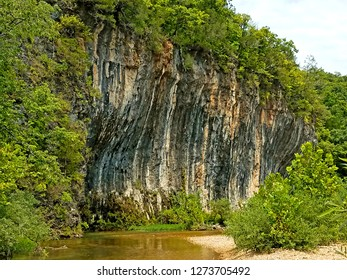 Tall rocky bluff over river