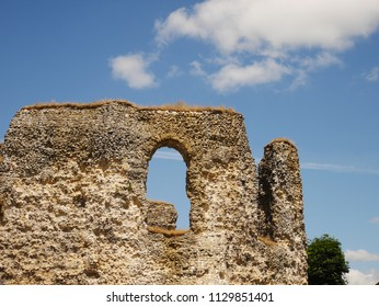 Tall ruined walls of Reading Abbey, Berkshire, England against blue sky
