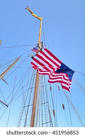 Tall ship Pride of Baltimore II mast with US flag on it, Toronto harborfront, Canada