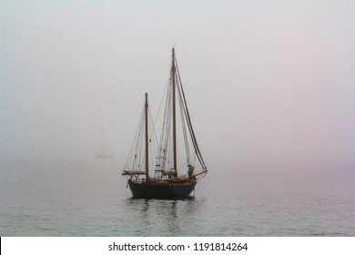 Tall ship sailing in the sea in foggy misty day