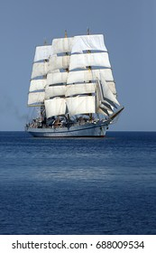 tall ship with wind-filled sails