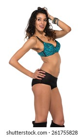 Tall slender brunette in a sequined blue bra and black shorts