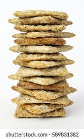Tall stack of wheat crackers. Vertical.