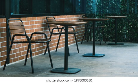 Tall table - Wooden table steel legs simplistic, tall bar stools in stylish kitchen with wooden cupboards.