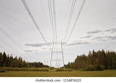 The tall towers hold the power lines in the rural Finland. The lines can be drawn straight when there's a lot of space like in these parts of the country.