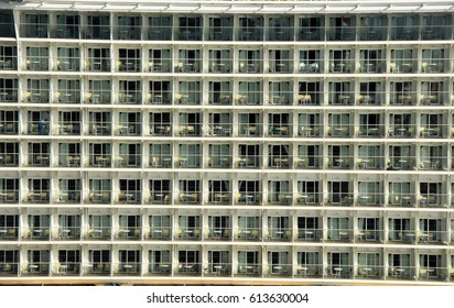 Tall wall with multitude of windows and balconies