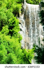 Tall waterfalls on the bright summer day
