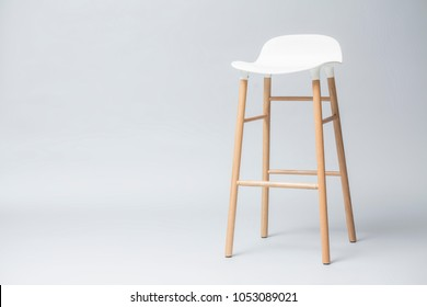 tall white bar stool legs are wood on gray background, Modern designer Bar chair