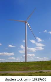 Tall wind turbine in field
