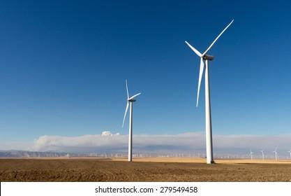 Tall wind turbines generating clean renewable energy