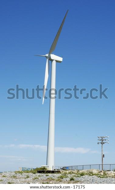 A Tall windmill, against a blue sky