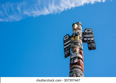 Tall wood carved Totem pole on Vancouver Island, British Columbia, Canada.