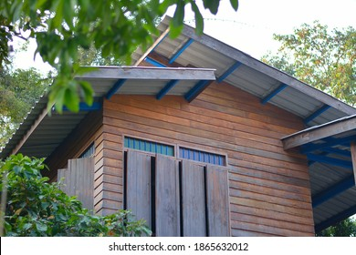 Tall wooden house, Thai style house, built with wood and tiled roof.