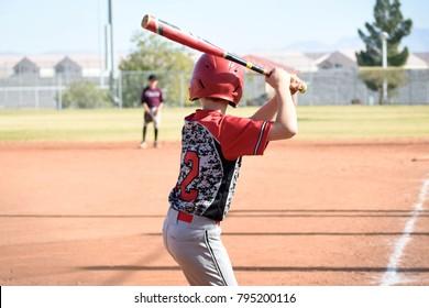 tall youth baseball player up to bat