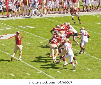 TALLAHASSEE, FL - OCT 16:  Florida State University's quarterback, Christian Ponder (#7), looks for open receiver as Boston College lineman press forward on October 16, 2010 at Doak Campbell Stadium in Tallahassee, FL.