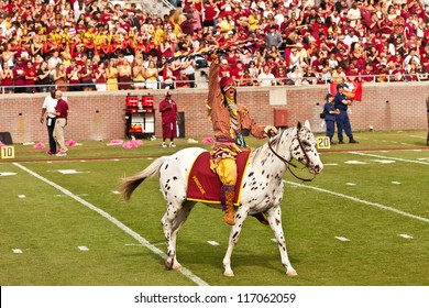 TALLAHASSEE, FL - OCT. 27:  Chief Osceola, riding Renegade, gets the crowd going prior to a football game between Florida State Seminoles and Duke University at Doak Campbell Stadium on Oct. 27, 2012.