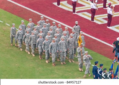 TALLAHASSEE, FL - SEPT. 26:  Military recruits walk off football field after national anthem at Florida State University vs. South Florida football game at Doak Campbell Stadium on Sept. 26, 2009. in Tallahassee, FL.