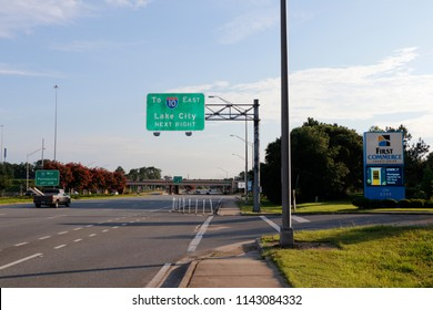 Tallahassee, FL, USA - July 14, 2018: Street sign to Lake City highway 10 East entrance in the early morning. Highway entry sign on Thomasville Road to Interstate 10 traveling east to Lake City