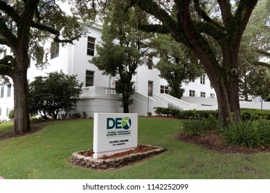 Tallahassee, FL, USA - July 15, 2018: Front sign and exterior facade of the Department of Economic Opportunity in downtown. Department of Economic Opportunity sign and building front in the morning.
