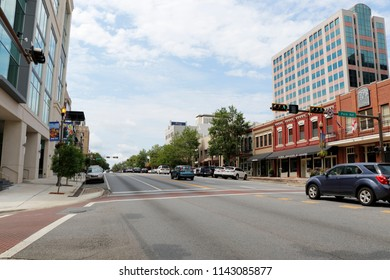 Tallahassee, FL, USA - July 15, 2018: Street view from East Park Avenue and South Monroe Street in downtown looking south. Looking south on South Monroe Street near East Park Avenue in the morning