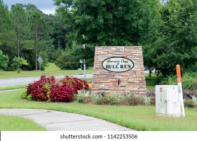Tallahassee, FL, USA - July 16, 2018: Neighborhood sign along a sidewalk and street in Albermarle Chase in Bull Run. Suburban Bull Run Albermarle Chase subdivision sign near a road and sidewalk.