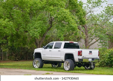 TALLAHASSEE, FL, USA - JUNE 11, 2019: White lifted GMC Pick up truck with big rims tires