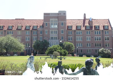 Tallahassee, Florida / USA - 10/03/2019 : Legacy fountain water fountain and statues at Florida State University in Tallahassee.
